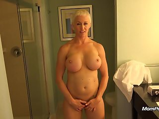 Big-busted MILF is a total freak