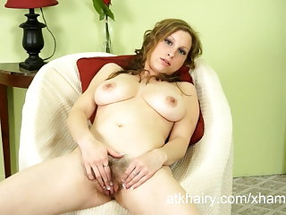 Hairy girl Sausha Packer shows off her hairy pussy