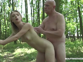 Enticing blonde Lily Ray grabs his cock and by fits sucking on it