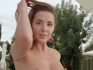 Homeric brunette Kailena stripping by make an issue of pool outdoor