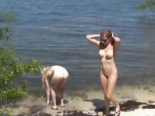 My girlfriend(the light blonde, small tits) and my wife, both 21 y.o., naked into the wild.