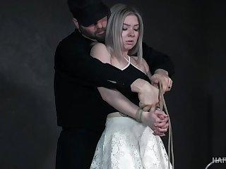 Tattooed blonde Kaiia Eve is fucked with a metal hook