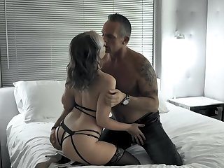 Muscular man impales hottie in black stockings on the bed